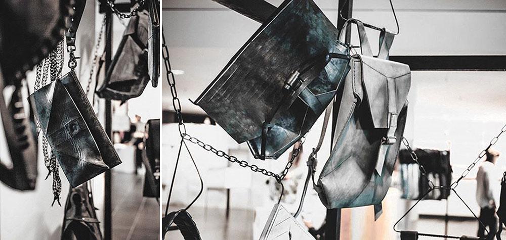 תיקי OMYURA תלויים על שרשראות מתכת בשבוע האופנה של קייב